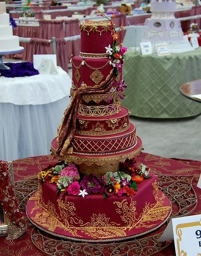 Simply magnificent Indian-themed wedding cake inspired by the intricate workings on a Hindi wedding veil, the minute and painstaking detail on this is mindblowing! Created by the extremely talented Erin Salerno, cake designer/sugar artist from Milwaukee, Wisconsin....