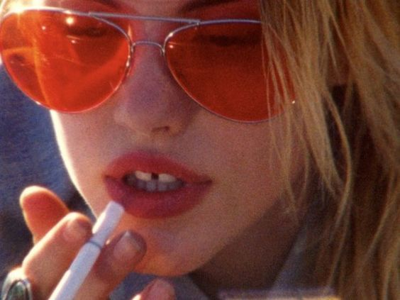 Attractive gal with a nasty cigarette in her mouth
