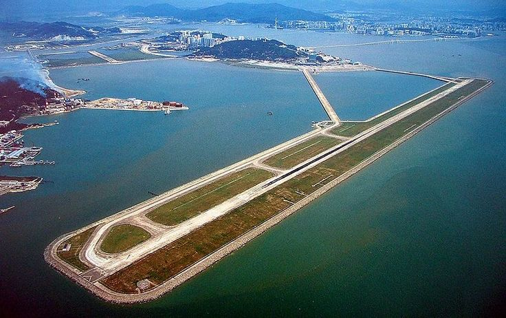 The Macau International Airport was built on land reclaimed from the ocean and opened in 1995. Bridges connect the runway to the control tower and terminal, located on a natural island.