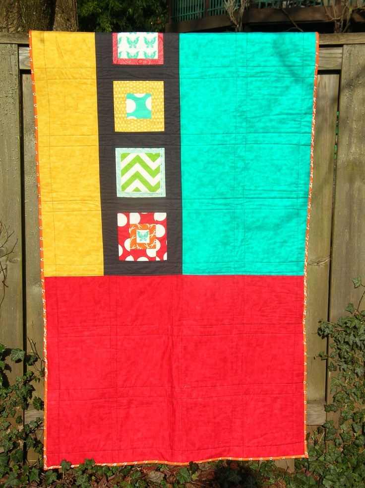The back of my first big quilt, colorblocked with some extra blocks