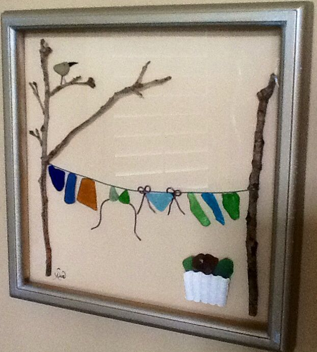 Too cute! Clothesline made of sea glass, shell, and branches...