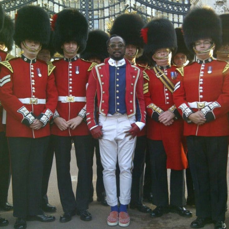 Will.i.am with soldiers outside Buckingham Palace.