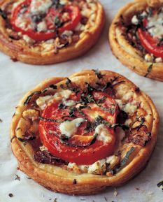 Ina Garten's tomato and goat cheese tarts. My favorite appetizer ever. Perfect for brunch.