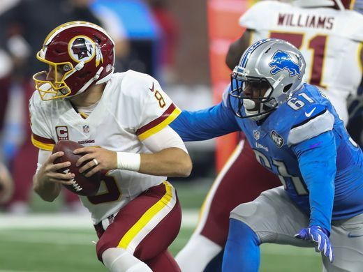 Redskins vs. Lions;   -   October 23, 2016  -  20-17, Lions  -     Washington Redskins quarterback Kirk Cousins tries to evade Detroit Lions defensive lineman Kerry Hyder on Sunday, Oct. 23, 2016 at Ford Field in Detroit.  Kirthmon F. Dozier, DFP
