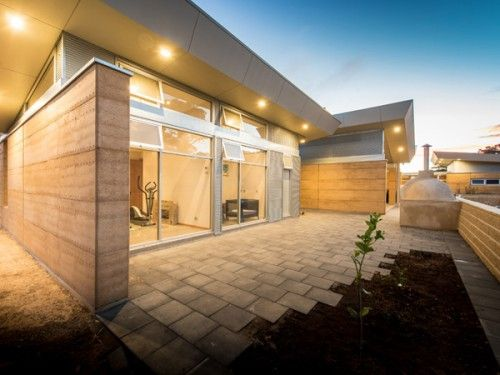 Rammed earth with brushed aluminium