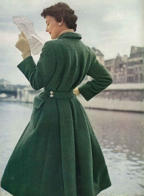 September Vogue 1952    The tweed is a green bouclé, a wonderful new green softened with grey. The coat is a redingote style, cut straight in the front and with deep pleats at the back held by a martingale. By Hermés.