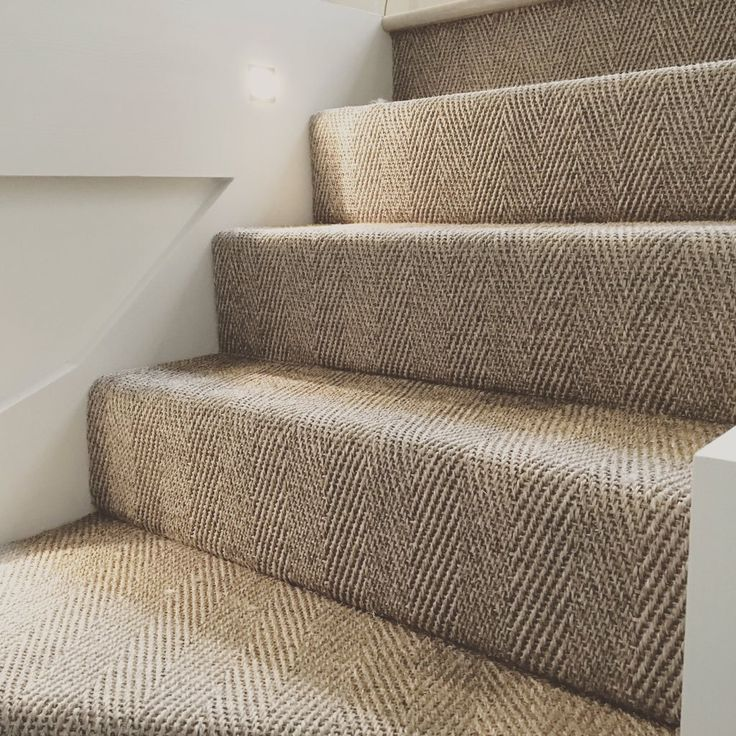 The herringbone weave leads the eye up the stairs nicely