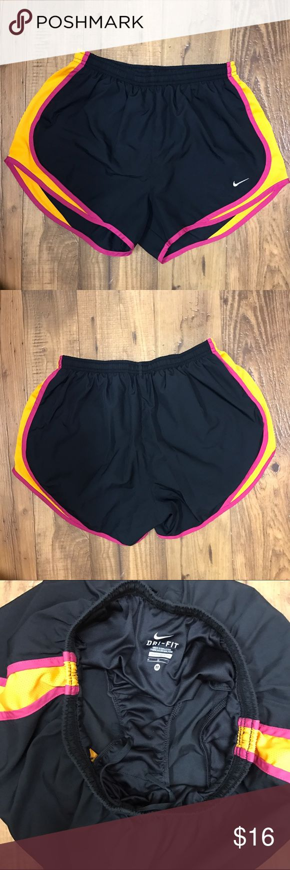 Nike Tempo Running Shorts Nike Tempo Running Shorts - black with pink and orange accents  Size M  Excellent condition.   💲💲OFFERS WELCOME💲💲 ❌❌NO Trades❌❌ Nike Shorts