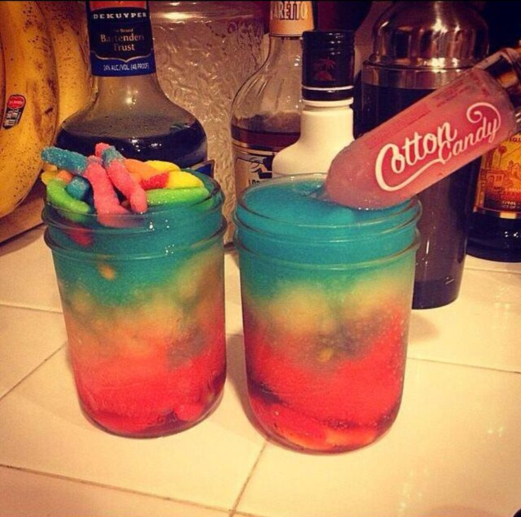 Currently obsessed with this cocktail! Shark Attack  RED LAYER: Vodka Grenadine  ORANGE LAYER: Vodka Orange Juice  BLUE LAYER: Malibu Rum Blue Curaçao   Plenty of ice & sour gummy worms!