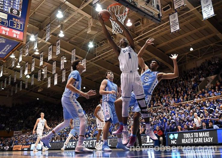 Duke forward Harry Giles (1) goes in against UNC forward Tony Bradley (5) to score during the first half of play at Cameron Indoor Stadium in Durham, N.C. Thursday, Feb. 9, 2017.