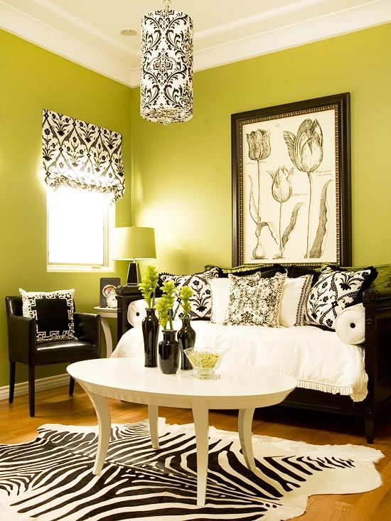 Minus the zebra throw rug, I want everything in this room recreated at my house. I love the green mixture with the black and white and patterns, and the simplicity to it. I've been wanting to do my living room in green for a while now because I feel like it's fresh and alive.