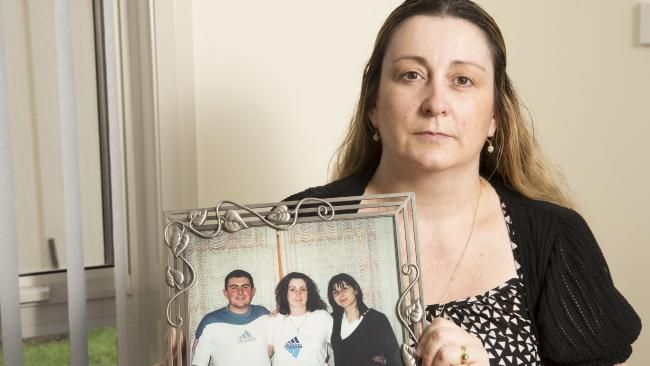 Maria Machuca holds a picture of her brother Alex who was killed in a car crash in 2004