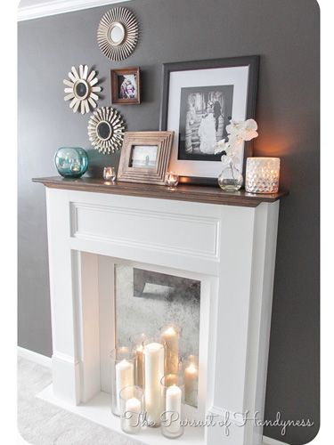 A faux fireplace can be just as cozy as the real thing. Decorate yours with a cluster of elegant candles and a mirrored backer to enhance the glow.
