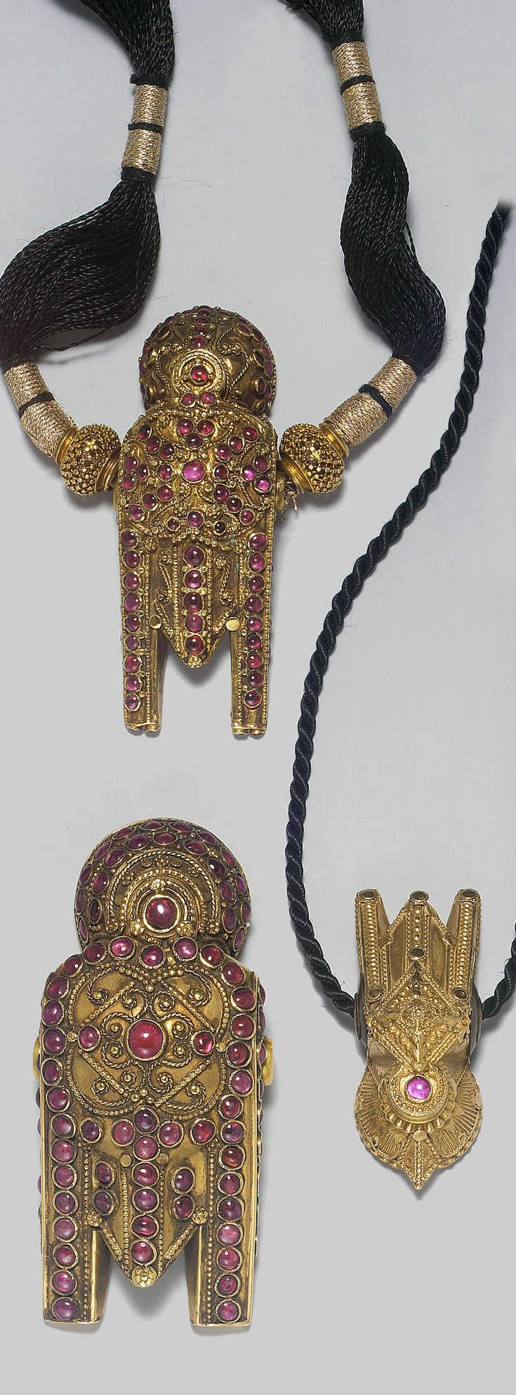 South India | Three gemset (mainly rubies) gold pendants | ca. 19th century | Largest Thali 7.7 cm | Est. 1'500 - 2'000£ ~ (Apr '05)