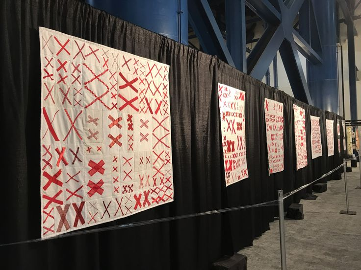 One wall of The 70273 Project Quilts in the special exhibit at the International Quilt Festival 2017