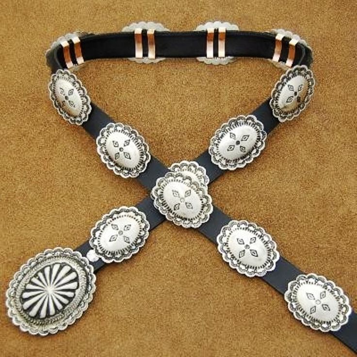Rocky Mountain Native American Silver Concho Belt. The perfect size for your Rocky Mt. blue jeans or to accessorize a skirt or dress. This concho belt is made with nickel silver so it won't tarnish and of course keeps the cost down. Made with substantial quality and weight and is of traditional Southwest design.http://www.nativeamericanstuff.net/Native%20American%20Concho%20Belts.htm