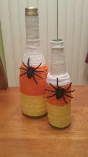 Yarn wrapped candy corn wine bottles. Tips: start from top when wrapping yarn, hot glue beginning of yarn and end only.