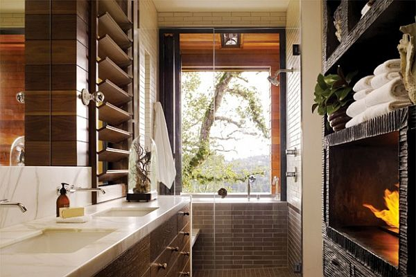 bathroom with a pool-like bathtub with black wall ceramics and a plant