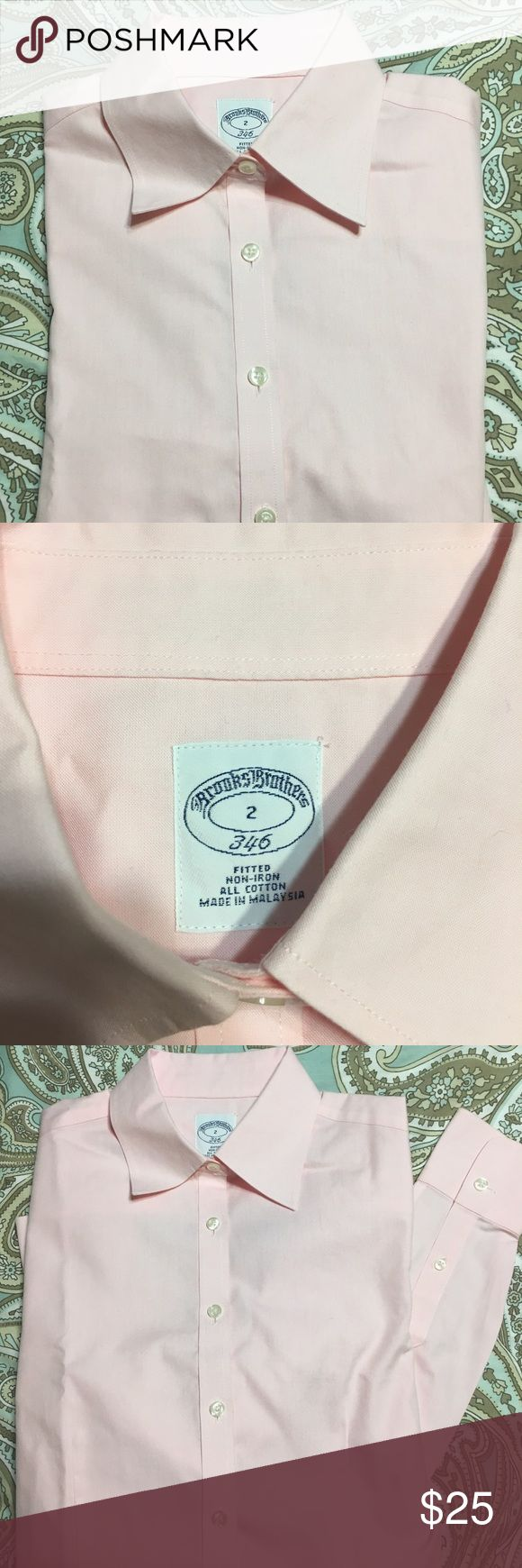 Brooks Brothers dress shirt size 2 Light pink brooks brothers non iron dress shirt size 2. In great condition. Skirt in picture not for sale. Just used for styling. Brooks Brothers Tops Button Down Shirts