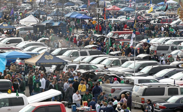 Tailgaters gather in a parking lot before the Notre Dame vs. Pitt football game on Saturday in South Bend, Ind.