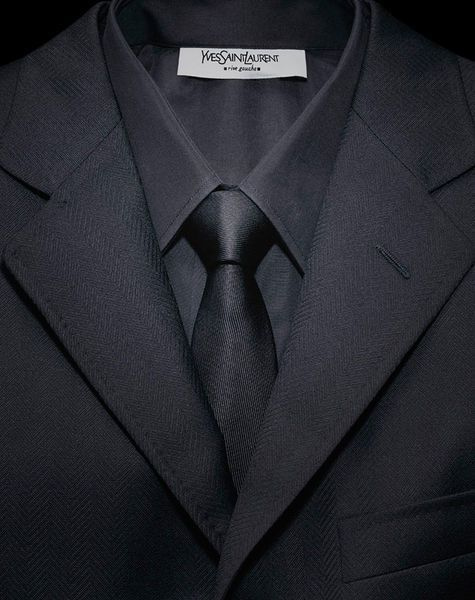 Funeral Outfits: What to Wear at a Funeral. Dark charcoal suit and tie for men.