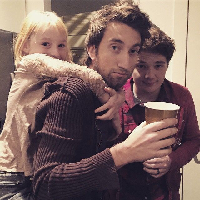 Gavin Piggy backing Millie next to Michael, they look like two gay dads and their daughter. Mavin