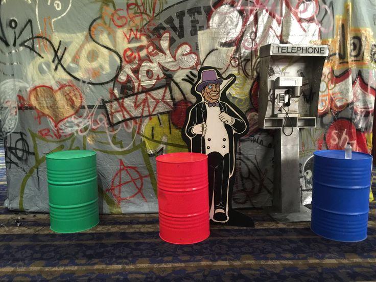 superhero event, telephone booth, grafitti, gallon drums 44, backdrop, penguin man