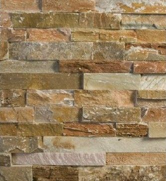 From http://besthomedecorators.com/stone/stone-wall-tiles.html. Tile behind wood stove idea