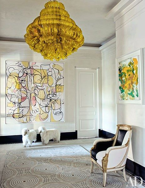 A Jacopo Foggini light fixture from Bernd Goeckler Antiques hangs in the…