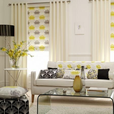 Clarke and Clarke -  Nouveau Fabric Collection - Plain white curtains with yellow and grey patterned roman blind and various modern cushions...