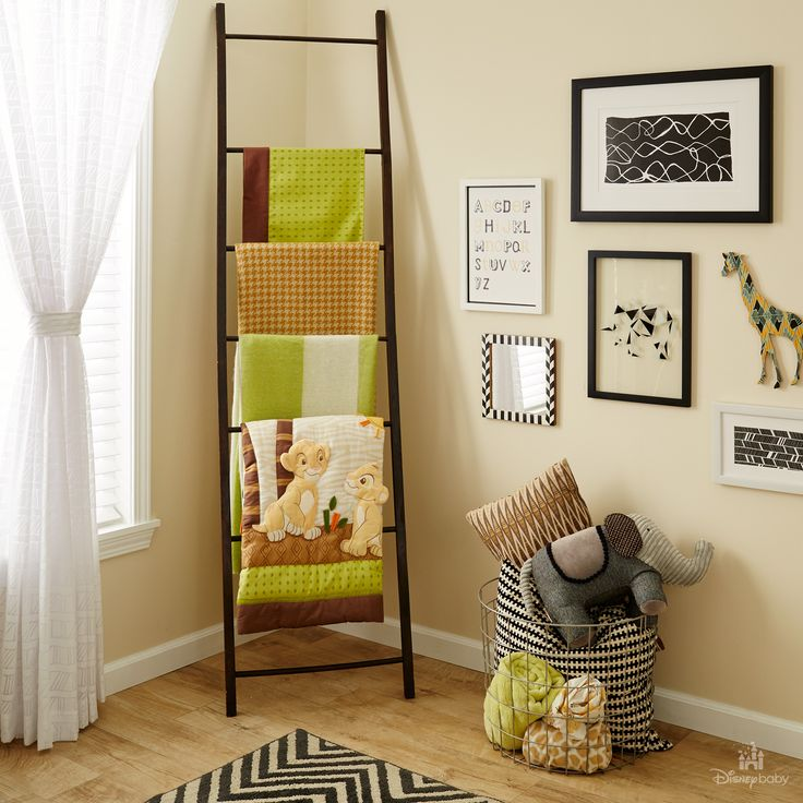 Gallery walls & linen ladders steal the show in this Lion King-inspired nursery! #WhatsInMyNursery #DisneyBaby