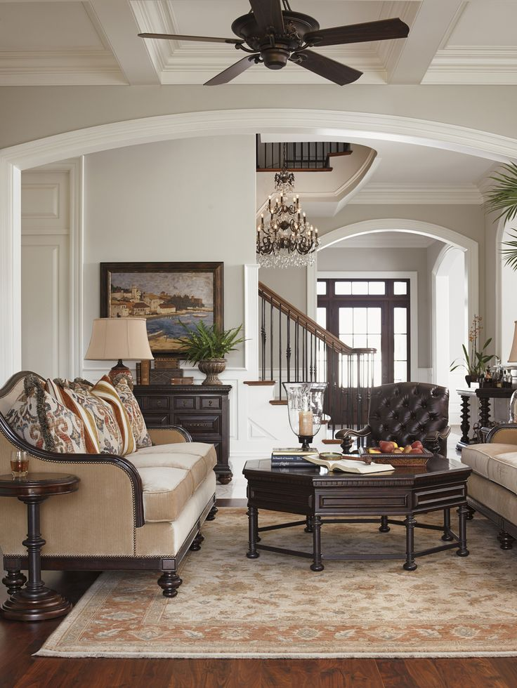 this european classic style living room features the kilimanjaro monrovia octagonal cocktail table from lexington home brands