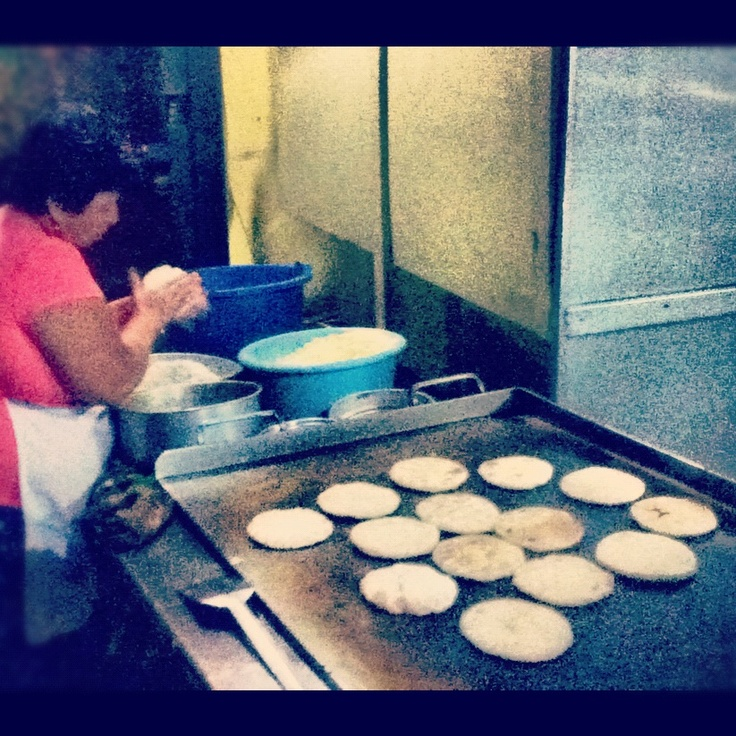 "Pupusas El Salvador.  These aren't ""our"" ladies at La Magdalena, but the scene is very familiar - we eat a lot of those tasty pupusas!"