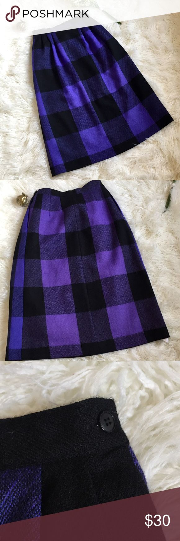 "Vintage purple/black plaid wool skirt Vintage plaid skirt. Violet purple and black plaid 100% wool. Thin diagonal stripes on some parts of the purple. Pair with your favorite blouse to create he perfect vintage look ✨ Button closure on side. In excellent condition. Size tag missing but waist measures approx 13.5"" (roughly size 8) and 30"" long. Vintage Skirts"