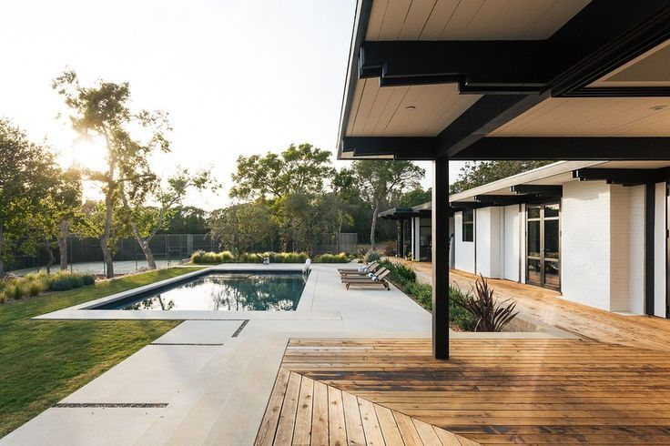 Swimming Pool Ideas After: Keeping with the style of the original house Monchamp chose a light stuc