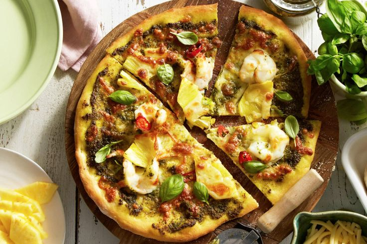 prawn pizza with pineapple and pesto.