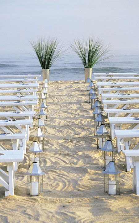 Beach wedding, how pretty. Plants and lanterns instead of arbor.