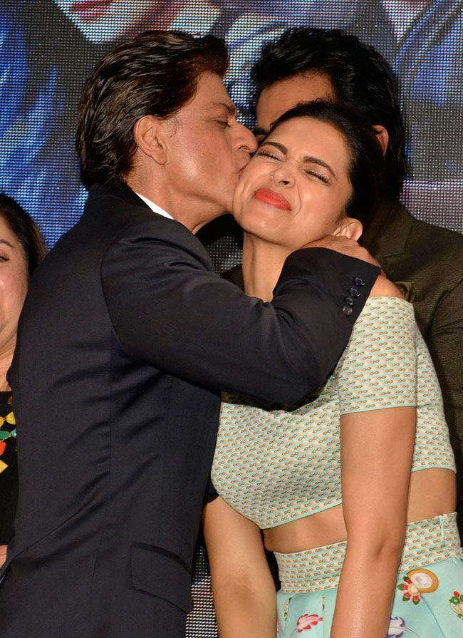 Shah Rukh Khan kissing Deepika Padukone at launch of Sharabi song from 'Happy New Year'.