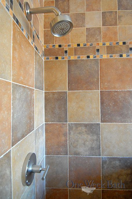 The beauty of the contemporary style shower is enhanced by using both large tile and small tile squares in this One Week Bath bathroom remodel. The neutral color scheme in this contemporary style bathroom is accentuated by bold designs and varied colors. Interested in renovating your bathroom? Contact us! #OneWeekBath #Brown #Bathroom