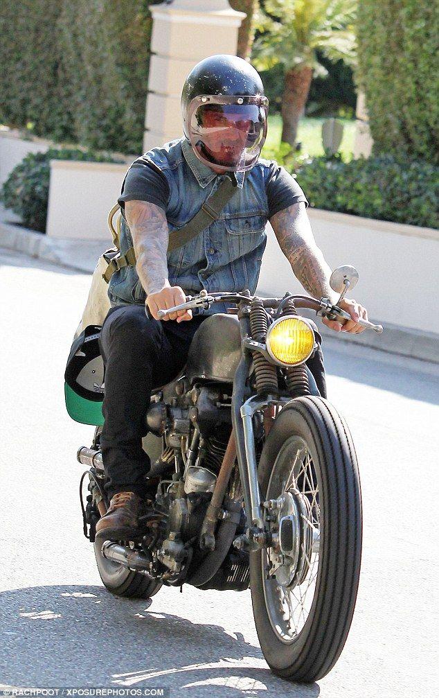 Biker chic: David Beckham goes for a ride around Los Angeles on his Harley Davidson...