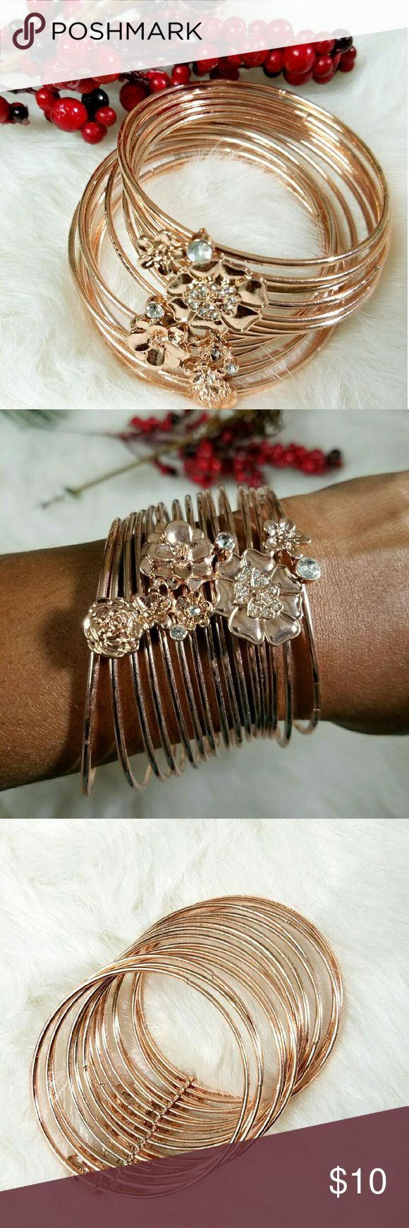 Rose Gold Plated Bangles The Bangles are all attached by this beautiful flower diamond Accent design. Absolutely stunning! Jewelry Bracelets