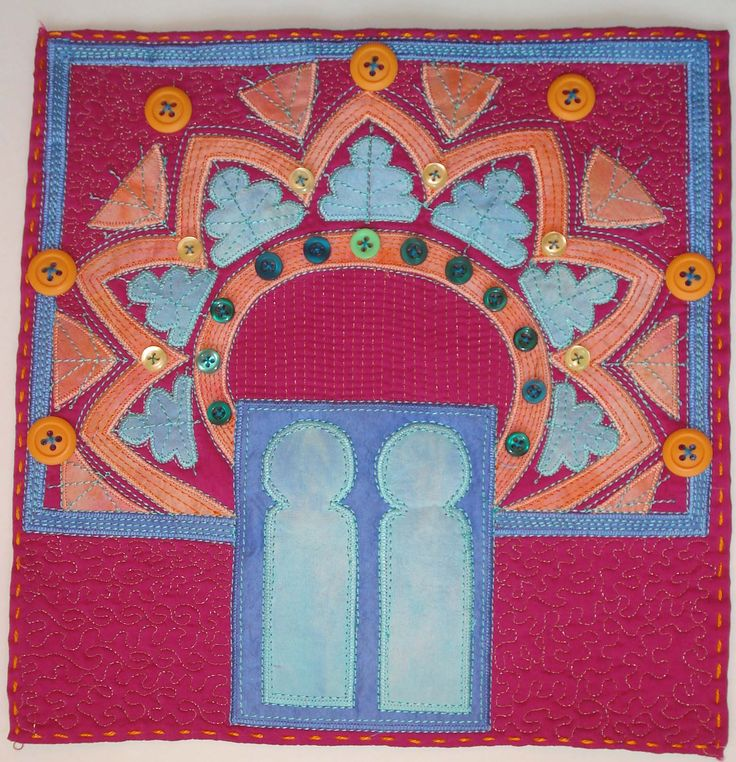 December: A very ornate window surround. Made with bonded appliqué, machine stitching and quilting. Made from silk by Greta Fitchett.
