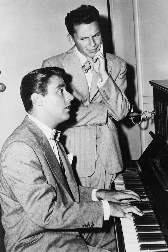 Sinatra and peter lawford during the filming it happened in brooklyn