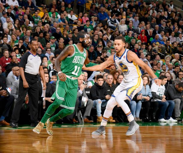Stephen Curry of the Golden State Warriors plays defense against Kyrie Irving of the Boston Celtics on November 16 2017 at the TD Garden in Boston...