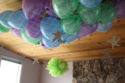 Disney 4th Birthday - Little Mermaid Party; LOVE the idea of using netting to contain the balloons