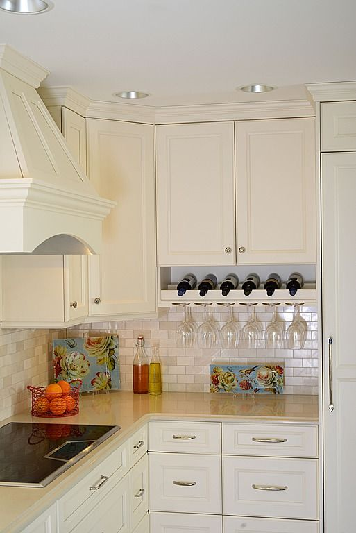 Classic white kitchen with built in wine rack. Designed by Leslie Jensen, Signature Design and Cabinetry, Tacoma WA.