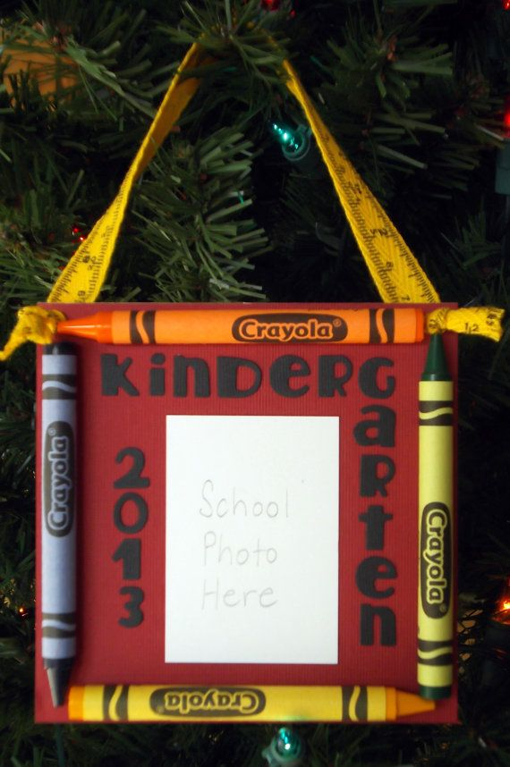 Cute school ornament..... I made these last year and had the kids wear a santa outfit in the picture. They came out SO cute!