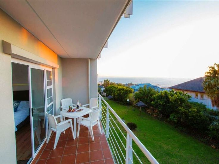 Oceana 15 - Central, self catering, 2 bedroom apartment in a secure complex offers Wi-Fi, a self catering kitchen with washer & dryer, living area with TV & dining area leading onto a balcony with stunning ocean & ... #weekendgetaways #campsbay #capetowncentral #southafrica