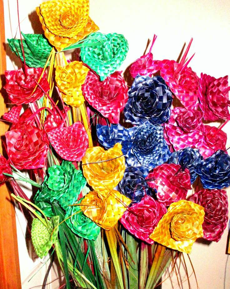 Flax woven flowers in a rainbow of colours - creations of Forever Flax