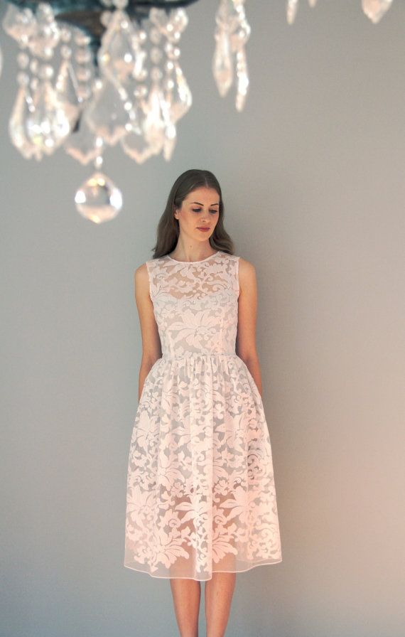 This stunning tea length organza dress, made of beautiful fabric, will adorn any womens wardrobe. The fabric is made from organza, the flowers on the